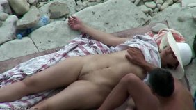 Seductive amateur enjoying her fingering on a beach