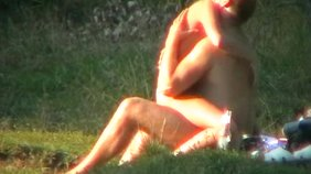 Blond-haired beauty rides this guy's cock outdoors