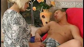 Wig-wearing blondie 69-ing with a big-dicked dude on the floor