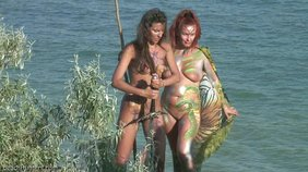 Tribal bodypaint hotties posing with swords and shit on a beach