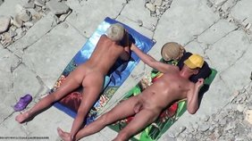 Short-haired blonde with a big butt showing off on a nudist beach