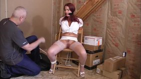 Redheaded bombshell with massive jugs showing off her tight body in this bondage vid