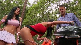 Lifeguard brunette helps her girlfriend take care of that massive cock