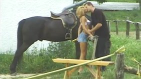 Whorish blond-haired girlfriend agrees to get fucked next to a fucking horse
