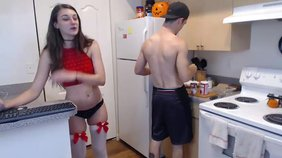 White stockings dark-haired GF sneakily teasing her pussy in the kitchen