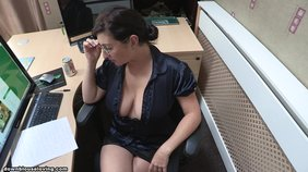 naughty brunette secretary is wearing her sexy glasses and hot blouse