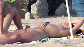 Skinny babe and her handsome boyfriend are sunbathing naked