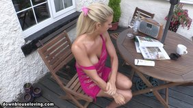 naive blonde is putting some suncream on her tits outdoors