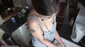 Glasses-wearing brown-haired girlfriend shows her perky tits while doing chores