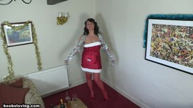 X-mas celebration with a tanned brunette bombshell in a red Santa-like get-up