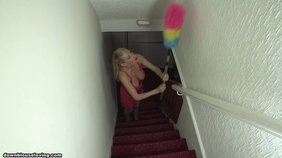Busty blond-haired bombshell in a pink dress is cleaning and showing her tits