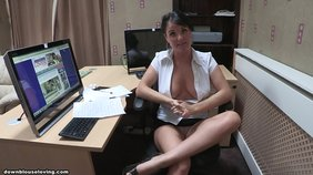 Dark-haired beauty flashes her immaculate breasts while on her computer
