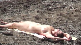 Thick brunette decides to lay down after enjoying some skinny dipping