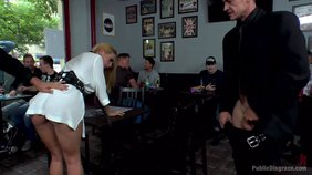 Vicious humiliation in public for a chic-looking blond-haired slave girl