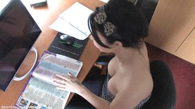 Brunette exposing her breasts while sitting at her desk, not doing much