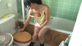 Sexy tanned girlfriend cleaning the bathroom while looking extremely sexy